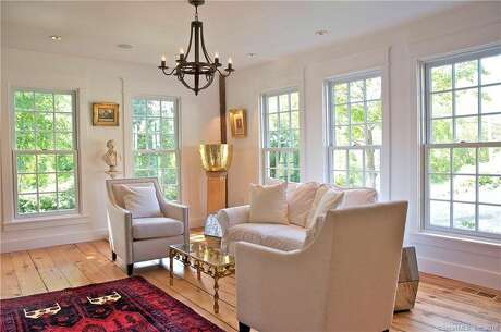A New Milford farmhouse built in 1750 has been completely restored and upgraded by the designer and artist who live there. The house at 214 Sawyer Hill Road once belonged to Helen Gallagher, a Tony-award winning Broadway performer who also appeared in television and film. Photo: Realtor.com