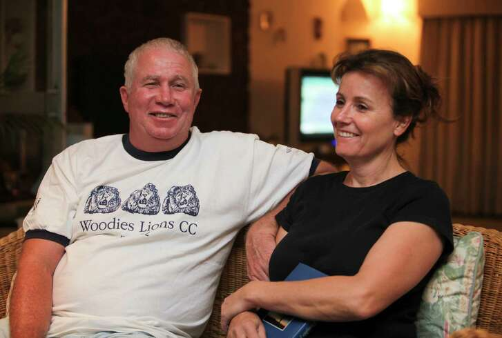 FILE - In this Oct. 16, 2009, file photo, shows Senior Zimbabwean MDC opposition official Roy Bennett, left, and his wife Heather, relax at a friends home in Mutare about 200 km east of Harare, Zimbabwe, following his release from prison. A fiery helicopter crash killed Bennett and his wife, while on holiday in a remote part of the U.S. state of New Mexico, authorities said Thursday, Jan. 18, 2018.