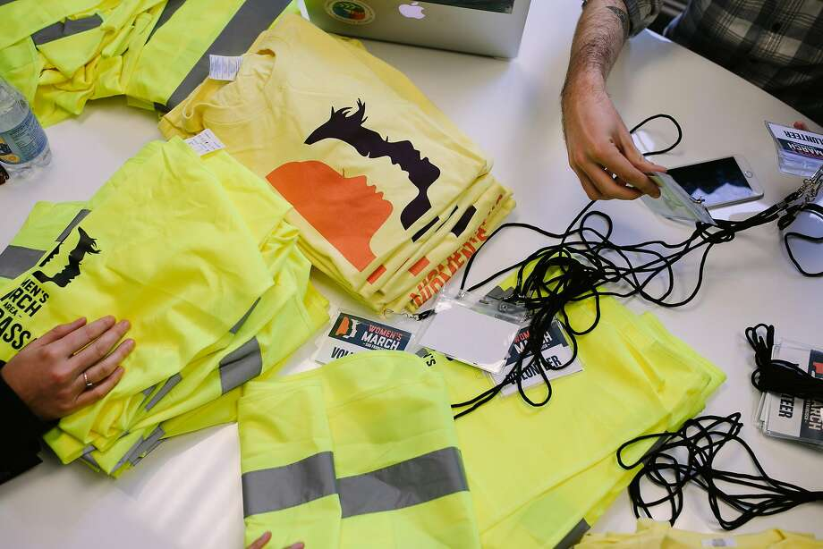 Volunteer shirts and vest for the Women's March are strewn across a table in San Francisco, Calif. Thursday, Jan. 18, 2018. Photo: Mason Trinca, Special To The Chronicle