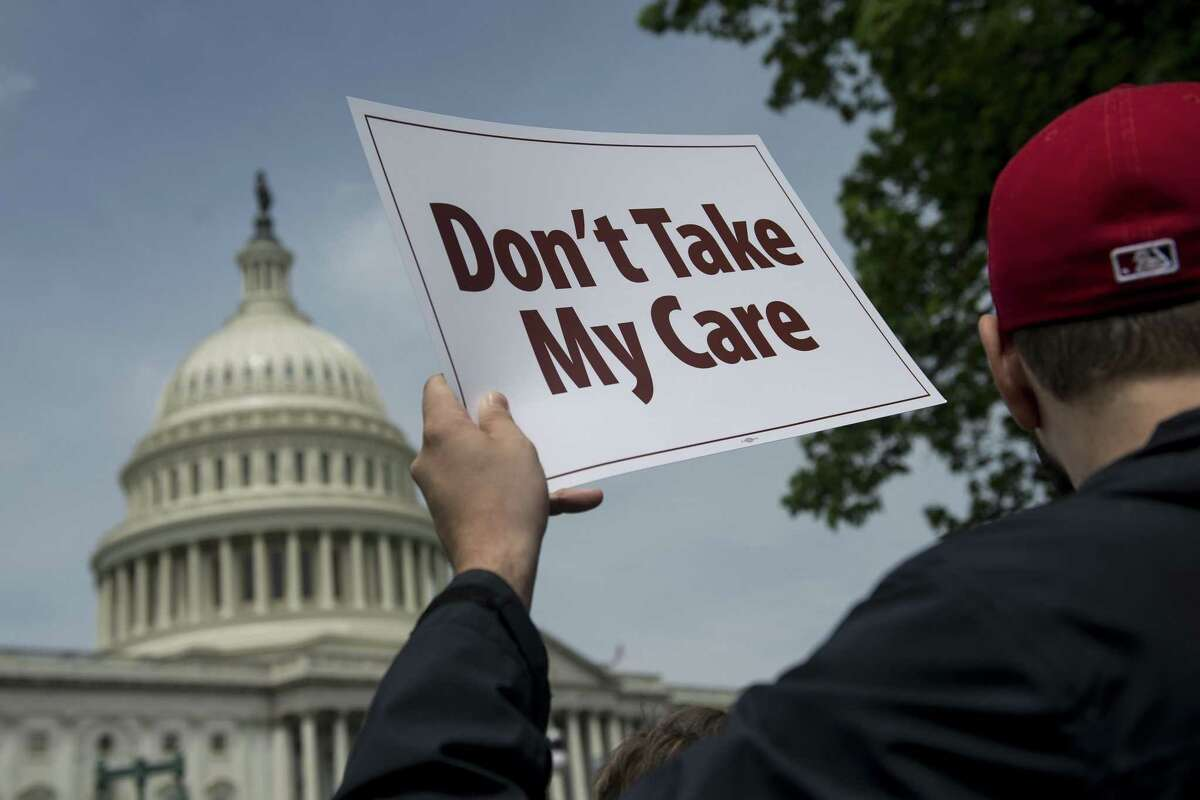 FILE-- Demonstrators protest as Republicans were presenting their health care bill last year.Researchers fear that changes to the Affordable Care Act could result in hundreds of thousands of Californians becoming uninsured by 2023.