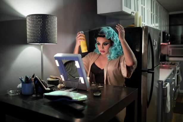 """Pixie Aventura in her home in New York, Dec. 6, 2017. """"RuPaul's Drag Race"""" has made stars of its contestants, catapulting many into full-fledged careers. But for some who have yet to catch this wave, drag is still an uncertain labor of love. (Jessica Lehrman/The New York Times)"""