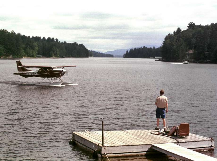 RANDY FREIMAN of Helms Aero Service waits for Tom Helms and his passengers to float up to the dock on Long Lake.  Helms is one of two commercial float plane businesses that visit Lows Lake (Times Union archive) Photo: Alan Wechsler / ALBANY TIMES UNION