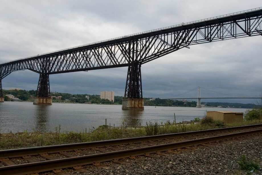 This is a view of the Poughkeepsie-Highland Railroad Bridge from the west side of the Hudson River. On Saturday the bridge becomes New York's newest state park, open to pedestrians to walk across and get a better view of the nearby Poughkeepsie train station and Mid-Hudson Bridge. (Humberto Martinez / Times Union) Photo: Humberto Martinez / Trax ID Number