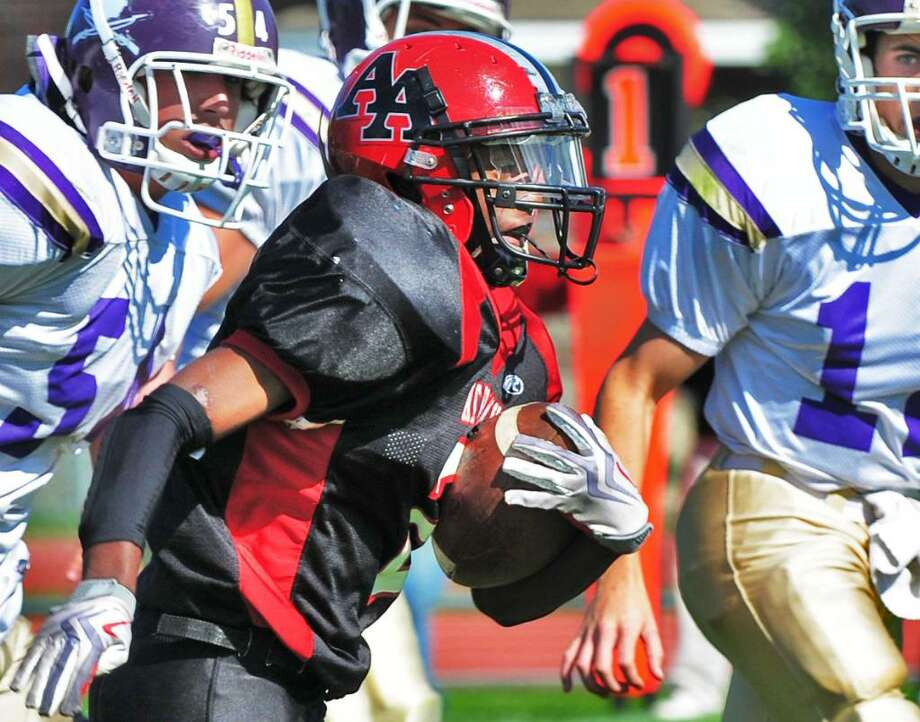 Academy running back Zay Richardson blasts through Johnstown defenders.  (John Carl D'Annibale / Times Union) Photo: John Carl D'Annibale / 00005603A