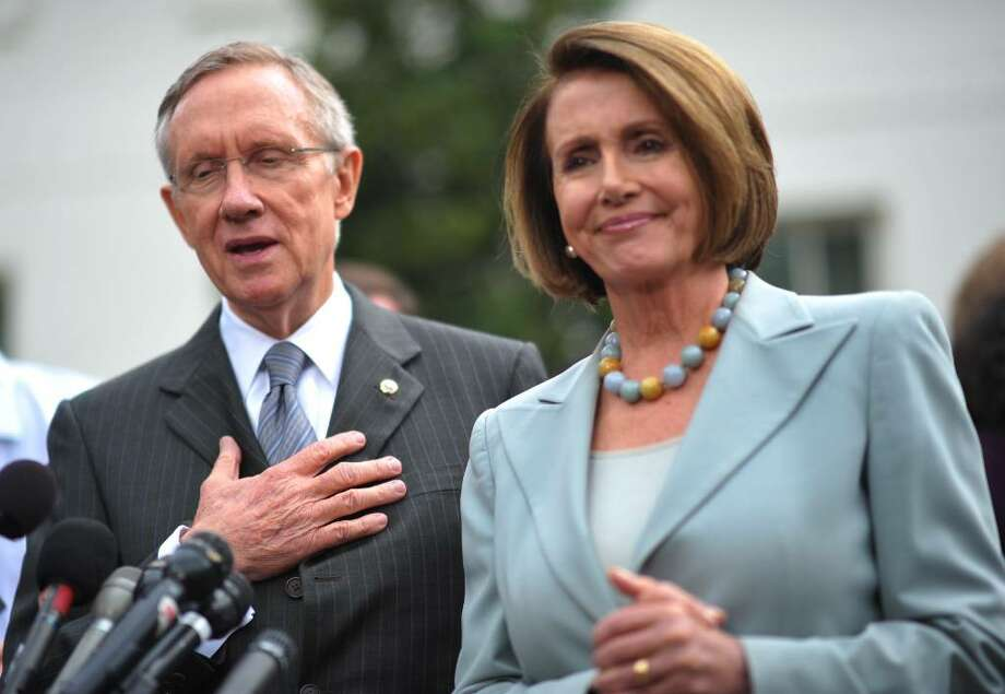 SENATE MAJORITY Leader Harry Reid, D-Nev., and House Speaker Nancy Pelosi, D-Calif., have produced differing bills on health care reform. A reconciliation process is next, with final votes in the House and Senate later. (MANDEL NGAN/GETTY IMAGES) Photo: MANDEL NGAN / AFP