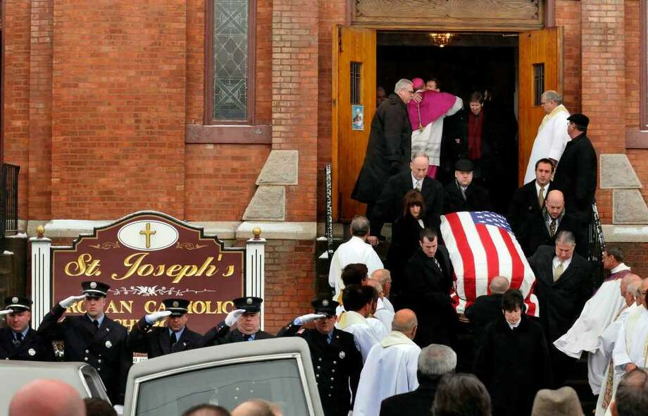 "The casket of John J. ""Jack"" McNulty Jr., 87, former Green Island mayor and supervisor and Albany County sheriff, is carried from St. Joseph's Church follwing the funeral service in Green Island,New York 01/02/2010.(Michael P. Farrell/Albany Times Union) Photo: MICHAEL P. FARRELL"
