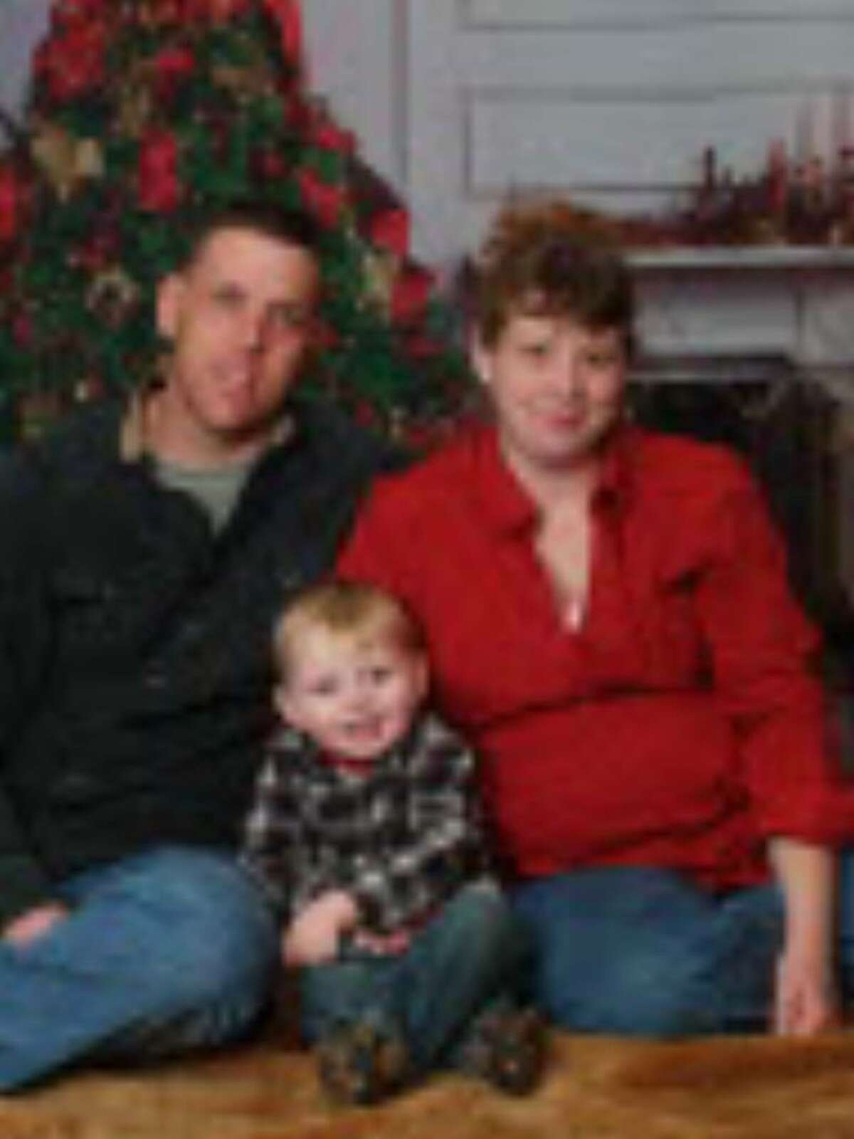 Jason Rivenburg, 35, of Fultonham, Schoharie County, is shown with his wife, Hope, and son Joshua in this family photo. Jason Rivenburg, a trucker, was shot to death in March in South Carolina. (Photos courtesy Rivenburg Family)