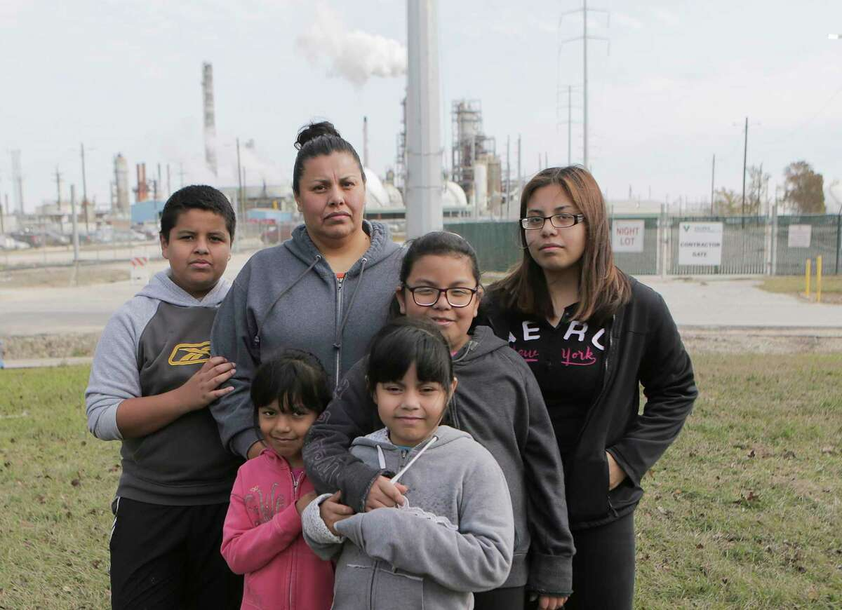Sarahi Touar stands in her front yard with her children Abraham, 11, (from left), Marisa, 5, Marion, 7, Camila, 8, and Dalila, 16 in their Manchester neighborhood on Saturday, Dec. 16, 2017, in Houston. ( Elizabeth Conley / Houston Chronicle )