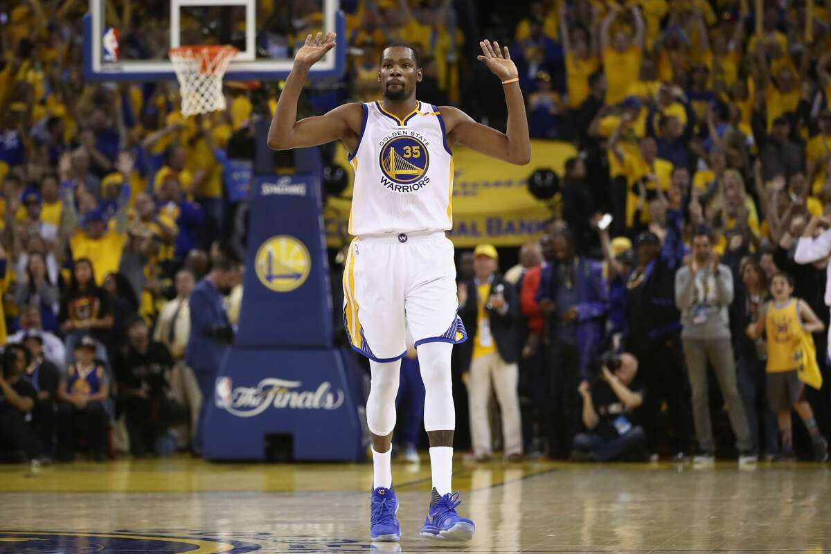 FILE-- Kevin Durant #35 of the Golden State Warriors celebrates in the final moments of their 129-120 win in Game 5 over the Cleveland Cavaliers to win the 2017 NBA Finals at ORACLE Arena on June 12, 2017 in Oakland.