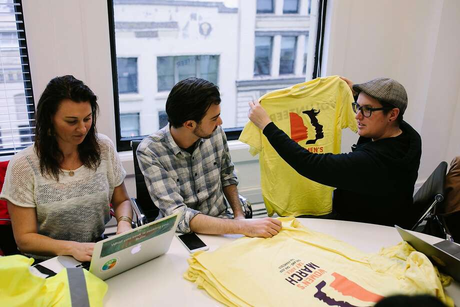 Bianca Hearfield, Edward Wright and Megan Rohrer get ready for Saturday's Women's March, San Francisco version. Photo: Mason Trinca, Special To The Chronicle