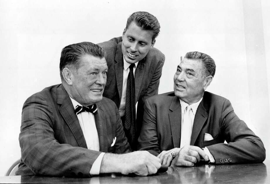In this Sept. 23, 1964 file photo, boxing heavyweights Gene Tunney, left, and Jack Dempsey, right, pose with Tunney's son, John Tunney, at a news conference in Los Angeles, California, on Sept. 23, 1964. Photo: Associated Press / AP 1964