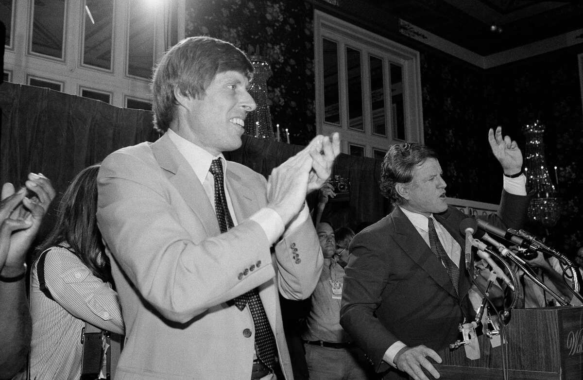 Sen. Edward Kennedy, D-Massachusetts, right, speaks to the California delegation to the Democratic Convention Aug. 11, 1980 at the Waldorf-Astoria hotel in New York City. John Tunney, former senator from California, applauds at left.