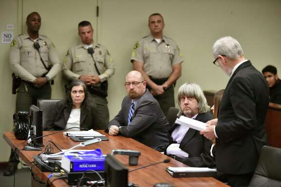 Louise Turpin, left, with attorney Jeff Moore, second from left, and her husband David Allen Turpin, listen to attorney David Macher at their arraignment in Riverside, Calif., on Thursday.