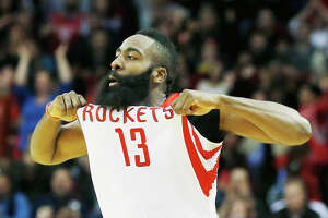 HOUSTON, TX - NOVEMBER 14:  James Harden #13 of the Houston Rockets celebrates after a three-point basket during the game against the Philadelphia 76ers at the Toyota Center on November 14, 2014 in Houston, Texas.  NOTE TO USER: User expressly acknowledges and agrees that, by downloading and/or using this photograph, user is consenting to the terms and conditions of the Getty Images License Agreement.  (Photo by Scott Halleran/Getty Images)