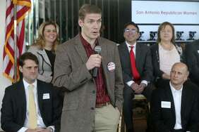 Congressional District 21 candidate Samuel Temple (fore- ground, holding the microphone) speaks on  Jan. 11 at the Old San Francisco Steak- house during a  meeting of the San Antonio Republican Women.