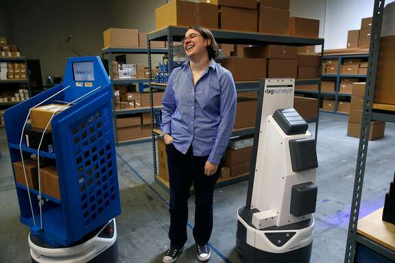 Fetch Robotics CEO Melonee Wise visits with autonomous mobile robots at the testing facility in San Jose, Calif. on Friday, Dec. 8, 2017.