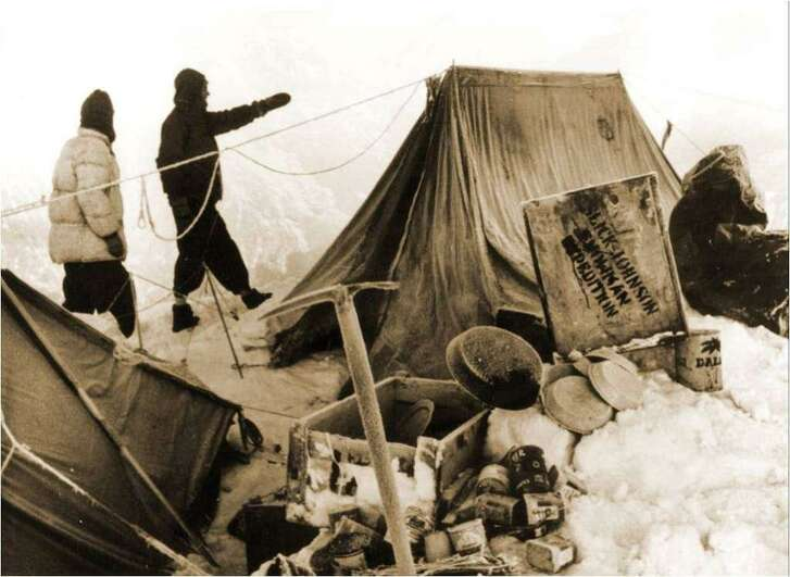 Tom Slick (pointing) photographed during his expedition in the Himalayas, looking for the Yeti.