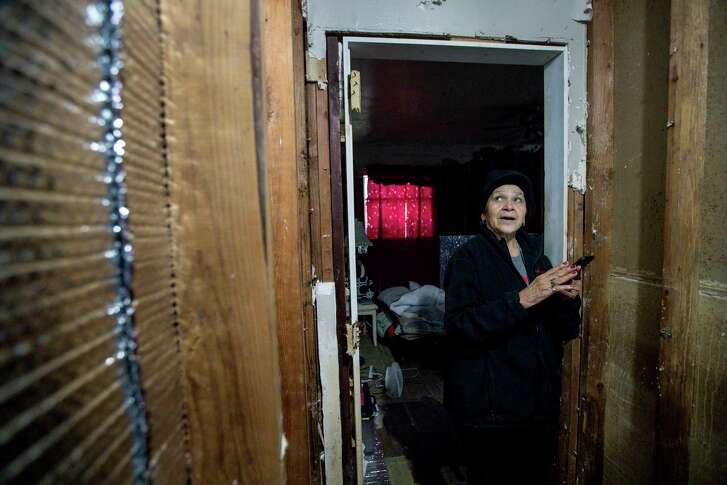 Paula Castro, 66, talks about the process of rebuilding after Hurricane Harvey brought several feet of water into her home, Wednesday, Jan. 3, 2018, in Houston. Castro's son put up temporary insulation in the home to help her deal with freezing temperatures during the previous few nights. Castro said an error in her application for FEMA aid kept her from getting enough money to repair more of her home.  ( Jon Shapley / Houston Chronicle )