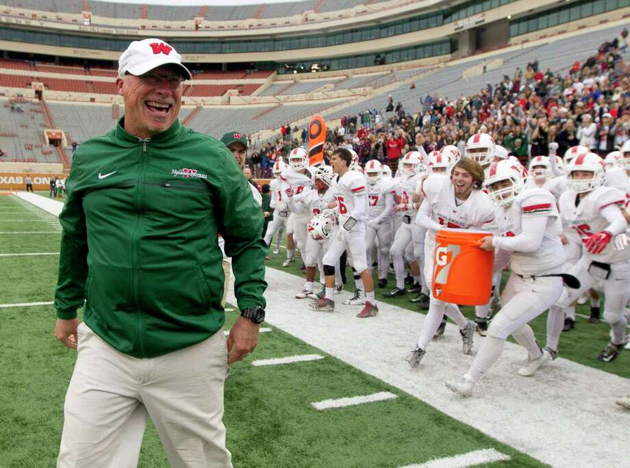 The Woodlands head coach Mark Schmid yells in celebration after the Highlanders knocked off Allen 36-28 in a Class 6A Division I state semifinal game at Darrell K Royal-Texas Memorial Stadium Saturday, Dec. 10, 2016, in Austin. Photo: Jason Fochtman, Staff Photographer / Houston Chronicle