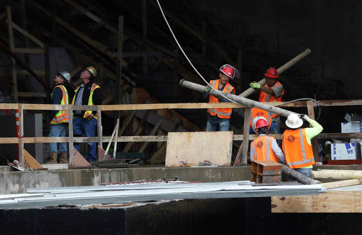 Construction workers on the site of The New Glassell School of Art at The Museum of Fine Arts, Houston, Thursday, Jan. 11, 2018, in Houston. ( Karen Warren / Houston Chronicle )
