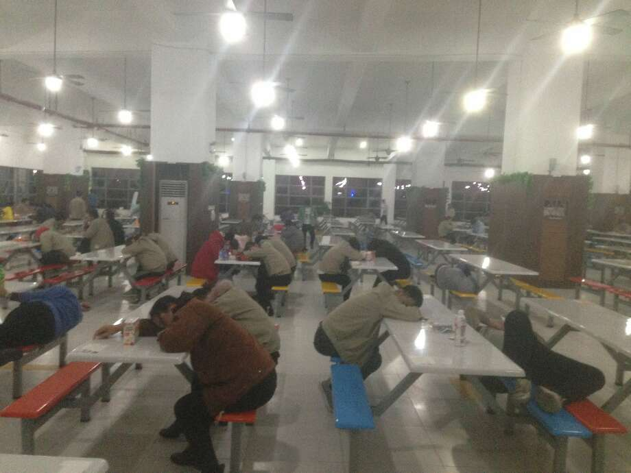 Workers sleep in the cafeteria of Catcher, a Chinese supplier to Apple, during the rest time following a meal. China Labor Watch investigated Catcher from October through January. Photo: China Labor Watch