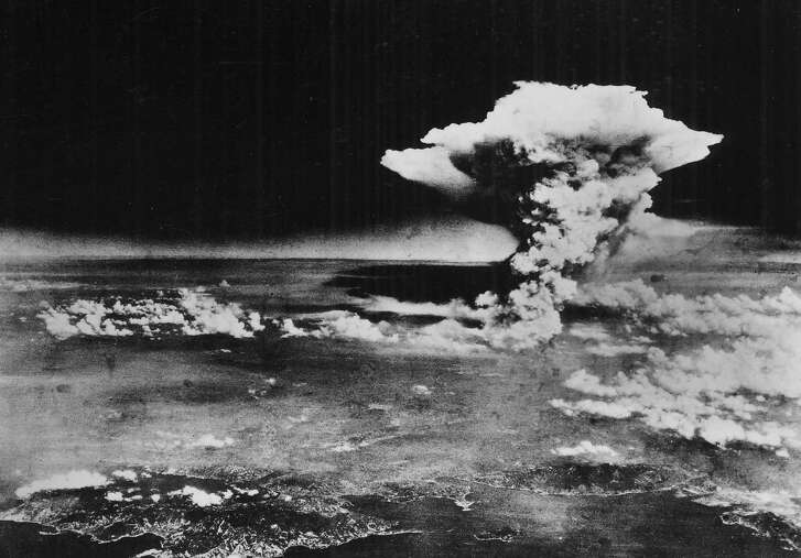 The mushroom cloud rises from Hiroshima, Japan, on Aug. 6, 1945, after the first atomic bomb was dropped by a B-29 bomber, as seen in this photo provided by the U.S. Army.  (U.S. Army via The New York Times)