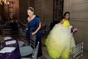Gala dinner chair Betsy Linder (left) looks over table settings as Laura Miller walks by before the start of the San Francisco Ballet Opening Night Gala at City Hall in San Francisco, Calif., on Thursday, January 18, 2018.