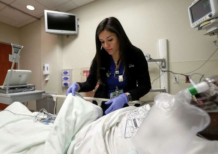"Susana Rosas, a DACA recipient and nurse, checks on a patient at Methodist Sugar Land Hospital, Thursday, Jan. 18, 2018, in Sugar Land. ""I feel like I make a difference every day, at least that's my goal,"" Rosas said. ""My status, whether I'm legal here or not doesn't take that away.""  ( Jon Shapley / Houston Chronicle )"