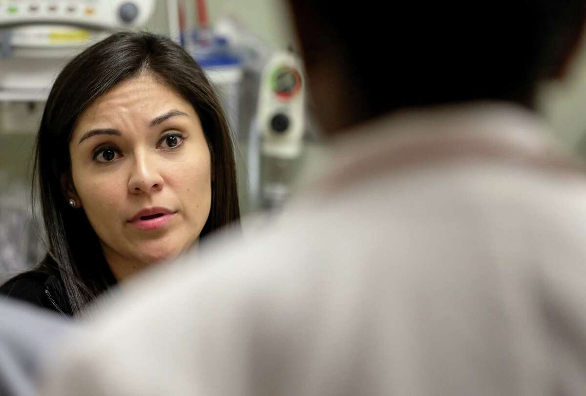 """Susana Rosas, a DACA recipient and nurse, talks to a doctor about a patient's care, at Methodist Sugar Land Hospital, Thursday, Jan. 18, 2018, in Sugar Land. """"I feel like I make a difference every day, at least that's my goal,"""" Rosas said. """"My status, whether I'm legal here or not doesn't take that away."""" ( Jon Shapley / Houston Chronicle )"""
