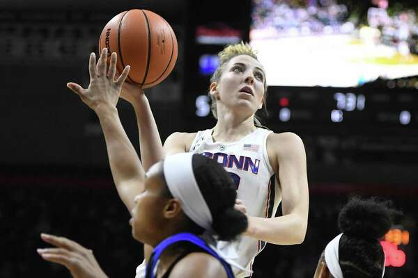 UConn's Katie Lou Samuelson, center, shoots while Tulsa's Erika Wakefield, left, and Alexis Gaulden defend Thursday in Storrs.