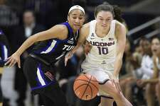 UConn's Molly Bent, right, steals the ball form Tulsa's Alexis Gaulden Thursday in Storrs.