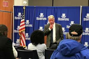 Chief State's Attorney Kevin Kane gives a crowd at Housatonic Community College information about ongoing investigations into police use of force.