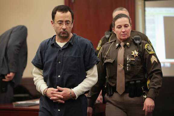 LANSING, MI - JANUARY 16:  Larry Nassar appears in court to listen to victim impact statements prior to being sentenced after being accused of molesting about 100 girls while he was a physician for USA Gymnastics and Michigan State University, where he had his sports-medicine practice on January 16, 2018 in Lansing, Michigan. Nassar has pleaded guilty in Ingham County, Michigan, to sexually assaulting seven girls, but the judge is allowing all his accusers to speak. Nassar is currently serving a 60-year sentence in federal prison for possession of child pornography.  (Photo by Scott Olson/Getty Images)