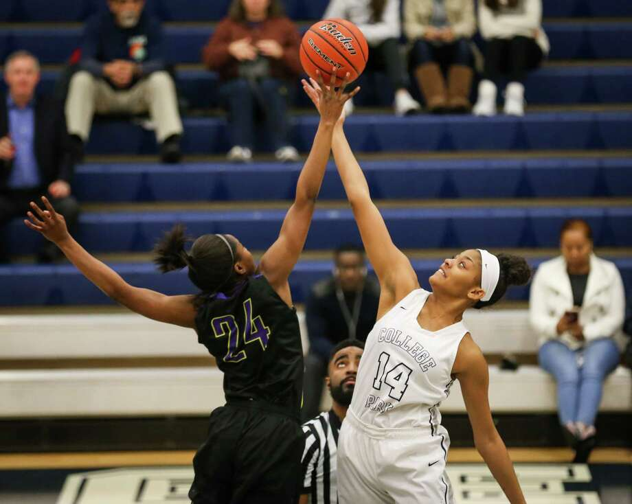 College Park's Sandra Cannady (14) and Montgomery's Da'Trinique Jones (24) battle for the tip off during the girls basketball game on Thursday, Jan. 18, 2018, at College Park High School. (Michael Minasi / Houston Chronicle) Photo: Michael Minasi, Staff Photographer / © 2017 Houston Chronicle