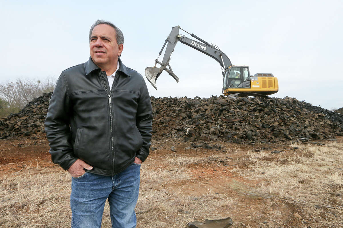 """State Rep. Tomas Uresti stands in front of a trackhoe atop a pile of shredded tires waiting to load them onto a truck at the infamous """"Safe Tire"""" site at 11150 Applewhite Road in San Antonio on Thursday, Jan. 18, 2018. Nearby Copart Inc. purchased the property in December with the intenion of removing the tires and expanding their operation to the site. An estimated 2,000,000 tires were at the site, though just under 1,000,000 currently remain. This action will alleviate the threat of fire and mosquito-borne diseases to San Antonio residents. Copart estimates the tires will be removed by May or June of this year, far short of the 300 days alloted by the Texas Commission on Environmental Quality, at an estimated cost of $2.8 million. MARVIN PFEIFFER/mpfeiffer@express-news.net"""