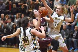 St. Luke's McKenna Frank, center, splits Greenwich Academy defenders Brooke Powers, right, and Casey Gotlieb during Saturday's FAA championship game in New Canaan.