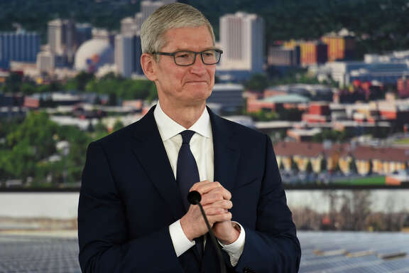 "Apple CEO Tim Cook pauses during his visit to Reno, Nev., for a ceremony celebrating a new Apple warehouse on Wednesday, Jan. 17, 2018. ""Apple is a success that could only have happened in America, and we always felt a very big sense of responsibility to give back to our country and the people who have made our success possible,"" said Cook on Wednesday. (Andy Barron/The Reno Gazette-Journal via AP)"