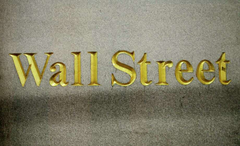 FILE - In this Oct. 8, 2014, file photo, a Wall Street address is carved in the side of a building in New York. Stock indexes are wavering between small gains and losses in early trading on Wall Street, Thursday, Jan. 18, 2018, as gains for technology companies are offset by losses in energy and other sectors. (AP Photo/Mark Lennihan, File) Photo: Mark Lennihan, STF / Copyright 2016 The Associated Press. All rights reserved. This material may not be published, broadcast, rewritten or redistribu