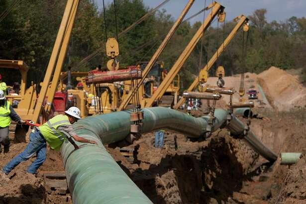 Crewmen work on TransCanada's Keystone XL project near Winnsboro in Wood County in 2012.