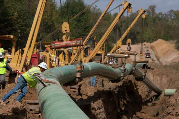 Crewmen work on TransCanada's Keystone XL project near Winnsboro in Wood County in 2012.