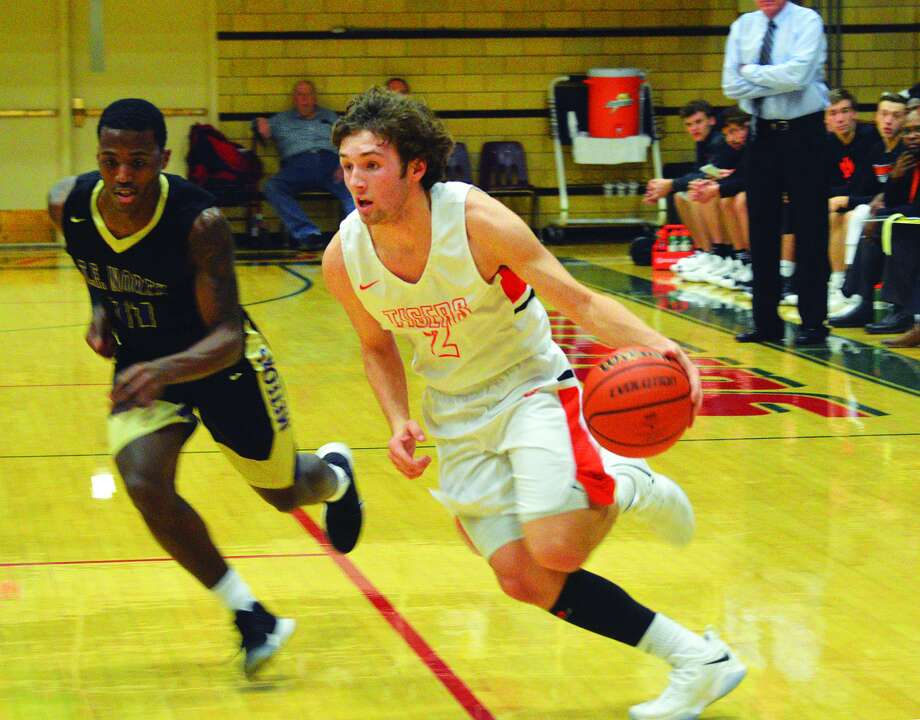 BOYS BASKETBALL Edwardsville wins tourney opener The