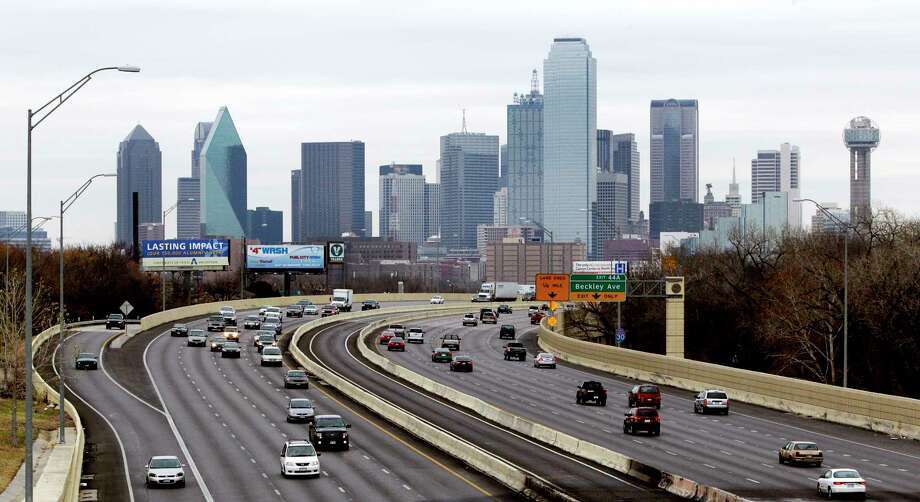 FILE - This Friday, Jan. 14, 2011, file photo shows highway IH-30 traffic with the Dallas skyline in the background. Dallas is one of the many cities vying to land Amazon's second headquarters. While Texas cities vying to land the new headquarters have been vocal about why they think they should win, they've resisted releasing copies of their proposals. (AP Photo/Tony Gutierrez, File) Photo: Tony Gutierrez, STF / Copyright 2018 The Associated Press. All rights reserved.