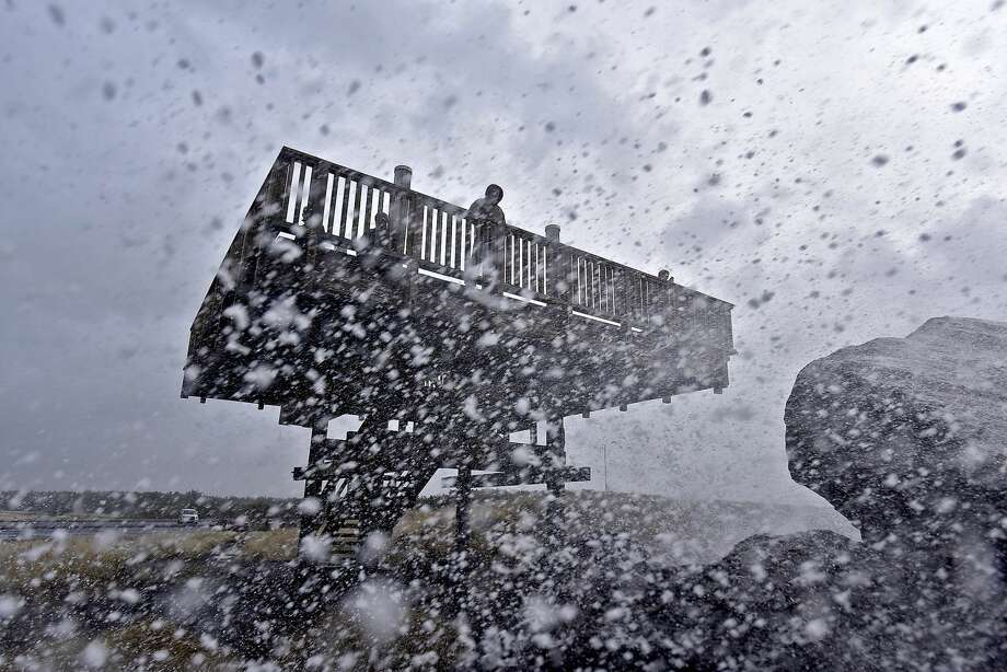Waves crash over the South Jetty at Fort Stevens State Park, Ore. as people take to the observation tower to watch the storm, Thursday, Jan. 18, 2018. (Colin Murphey/Daily Astorian via AP) Photo: Colin Murphey/AP