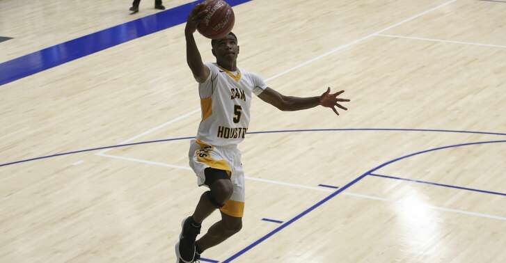 Sam Houston's Wayne Hampton (5) has the court for himself and scores a lay up during the first half of the game at HISD's The Pavilion on Thursday, Jan. 18, 2018, in Houston. ( Yi-Chin Lee / Houston Chronicle )
