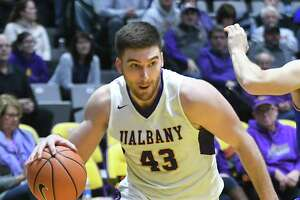 University at Albany's Greig Stire drives to the basket during a basketball game against Lowell at SEFCU Arena on Thursday, Jan. 18, 2018 in Albany, N.Y. (Lori Van Buren/Times Union)