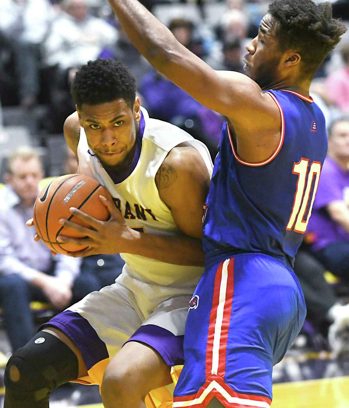 University at Albany's Alex Foster drives to the basket guarded by Lowell's Jahad Thomas during a basketball game at SEFCU Arena on Thursday, Jan. 18, 2018 in Albany, N.Y. (Lori Van Buren/Times Union)