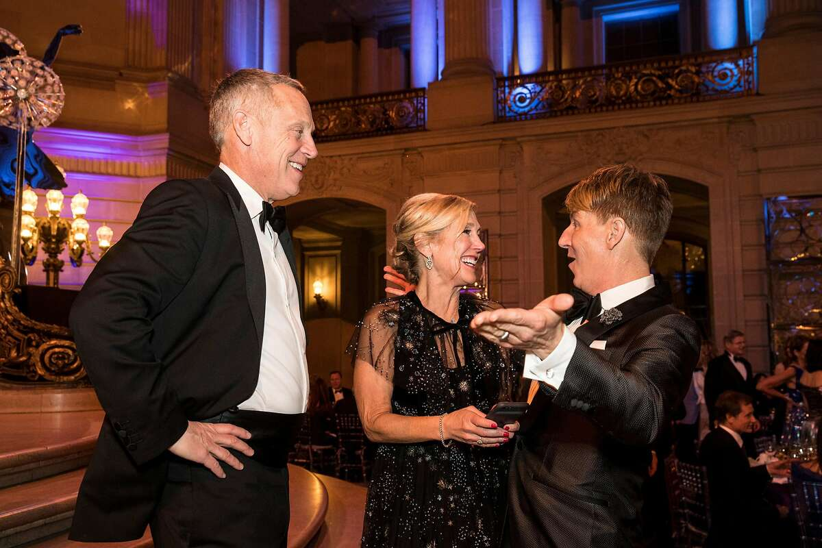 The gala chairwoman Kathy Huber (center) talks with Jack Calhoun (right) and her brother George Huber at the San Francisco Ballet Opening Night Gala at City Hall in San Francisco, Calif., on Thursday, January 18, 2018.