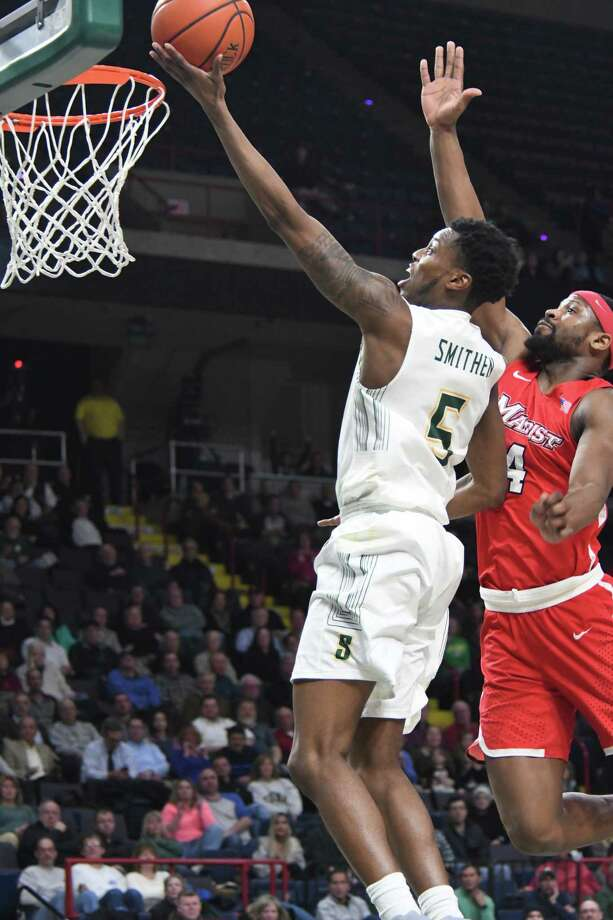 Siena's Kadeem Smithen jumps for the basket in the last minute of the game against Marist on Thursday, Jan. 18, 2018, at the Times Union Center in Albany, N.Y. Siena defeated Marist 68-65. (Jenn March/Special to the Times Union) Photo: Jenn March / © Albany Times Union © Jenn March Photography