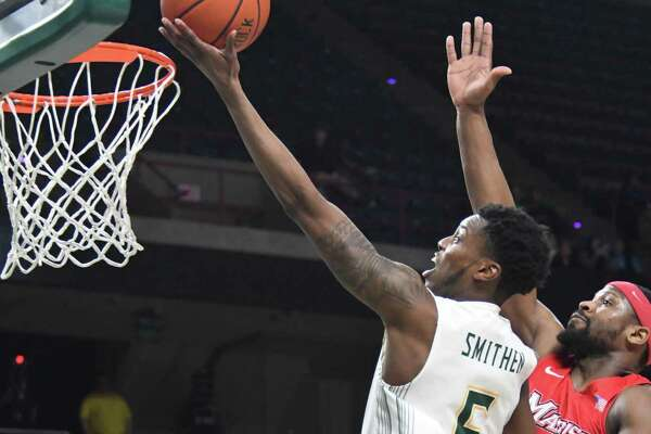 Siena's Kadeem Smithen jumps for the basket in the last minute of the game against Marist on Thursday, Jan. 18, 2018, at the Times Union Center in Albany, N.Y. Siena defeated Marist 68-65. (Jenn March/Special to the Times Union)