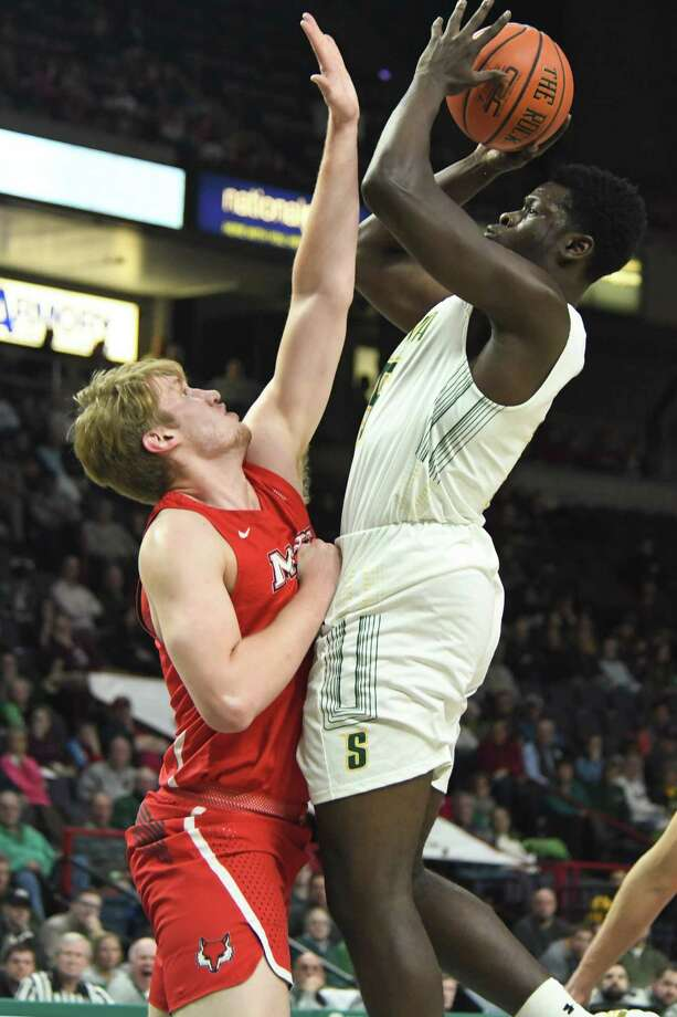 Siena's Prince Oduro jumps to make a shot as Marist's Tobias Sjoberg attempts to block during a game on Thursday, Jan. 18, 2018, at the Times Union Center in Albany, N.Y. Siena defeated Marist 68-65. (Jenn March/Special to the Times Union) Photo: Jenn March / © Albany Times Union © Jenn March Photography